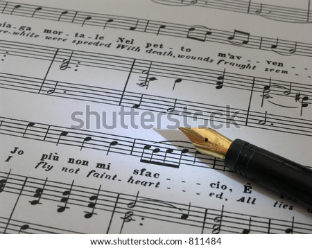 Music with old fashion pen on top