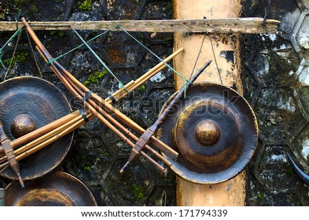 Musical background series. Bamboo ethnic flute and gong - stock photo