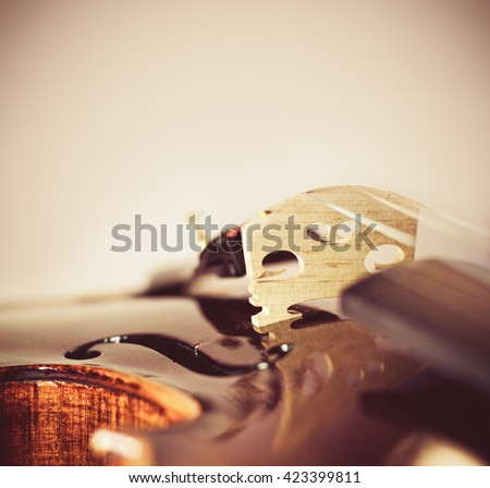musical background with violin bridge close-up - stock photo