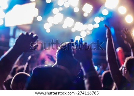 Musical Band. Cheering crowd at concert - stock photo