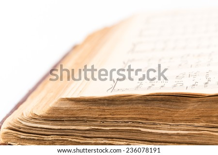 musical composition book opened over white background - stock photo