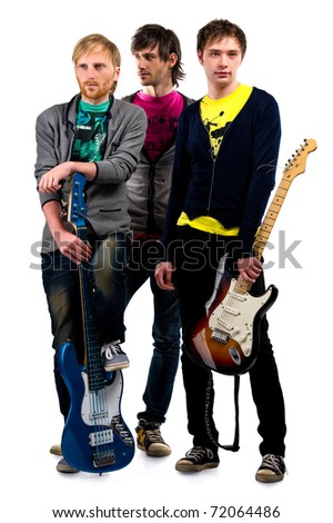 Musical group posing over white background - stock photo