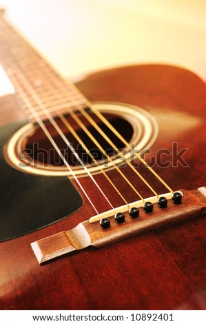 Musical instrument acoustic guitar close up in perspective - stock photo