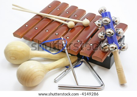 musical instruments laying on a white background - stock photo