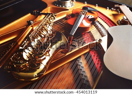 Musical instruments lying on piano, close up - stock photo
