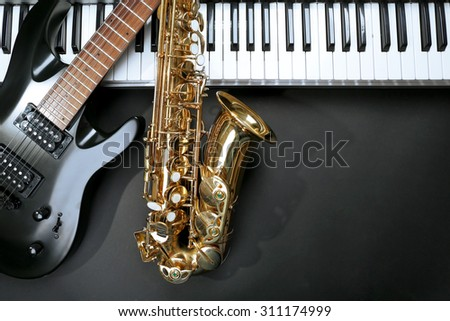 Musical instruments on black background - stock photo