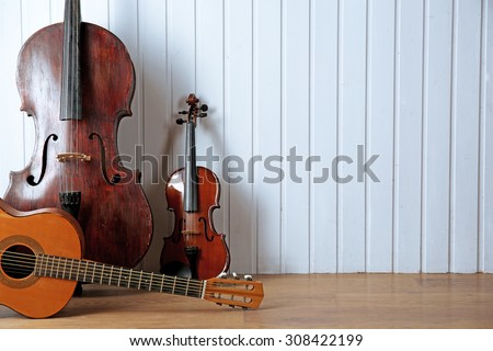 Musical instruments on wooden planks background - stock photo