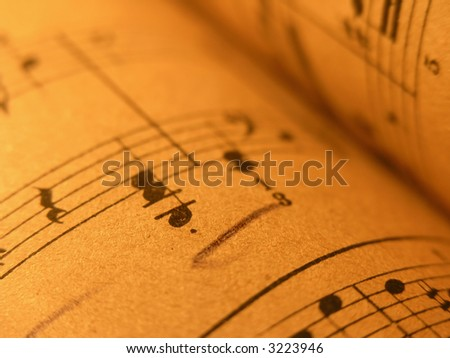 musical notation,old print,Close up of sheet music with warm lighting. - stock photo