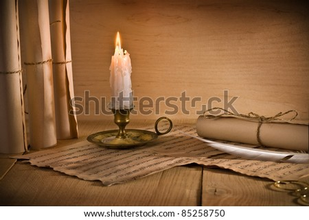 musical notes and candle - stock photo