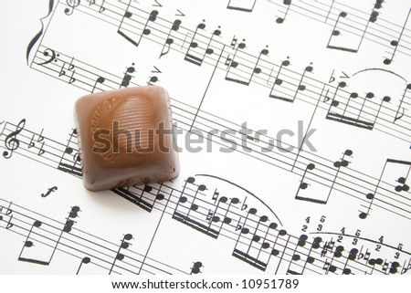 musical notes and chocolate background - stock photo