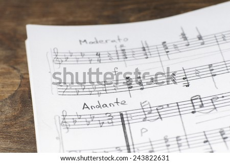 Musical notes and pencil, shallow DOF