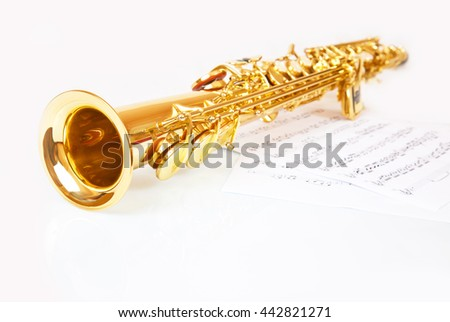 Musical notes and saxophone on a white background - stock photo