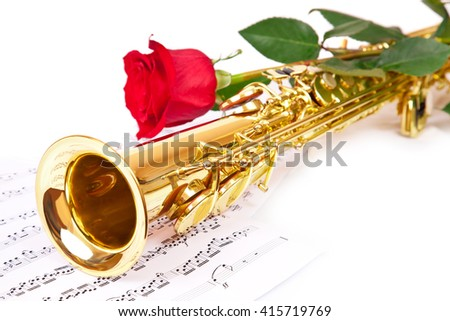 Musical notes and saxophone with red flower - stock photo
