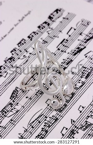 Musical notes and treble clef silver - stock photo