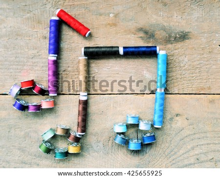 musical notes,spools of thread ,hobby concept - stock photo