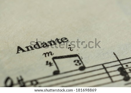Musical rate of the Andante on the textbook page - stock photo