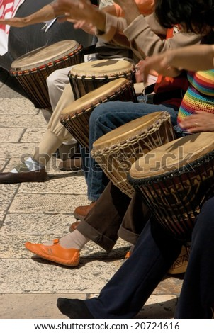 musicans playing drums during street concert in ancient city of split, croat - stock photo