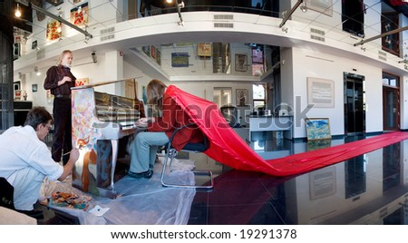 musician and artist during performance in  art gallery- panoramic image - stock photo
