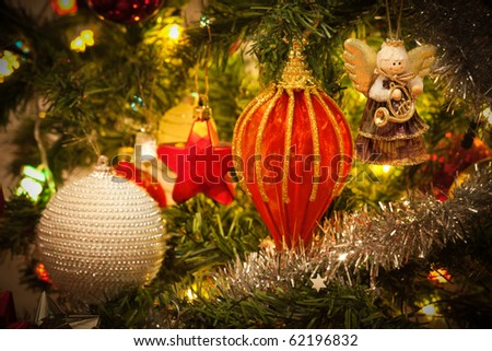 Musician angels hanging on the Christmas tree, close up - stock photo