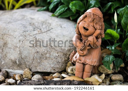 Musician clay sculpture in nature - stock photo