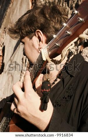 musician (finger-board in focus) - stock photo