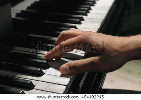 Musician hands playing piano