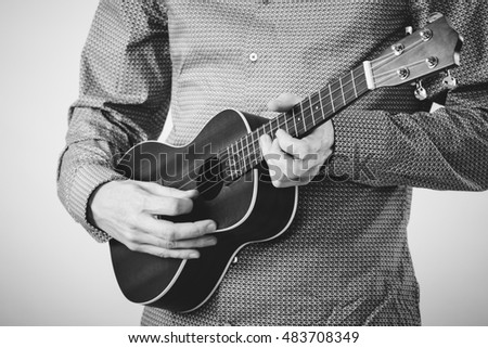 Musician Man With Ukulele Guitar - Black And White Color
