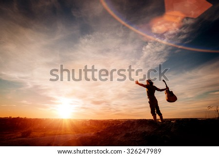Musician on the mountain. Sunset. Freedom. Background