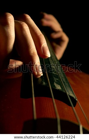 Musician playing contrabass - stock photo