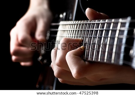 Musician playing guitar - stock photo