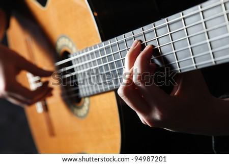 Musician playing guitar - stock photo
