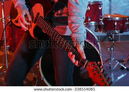 Musician playing guitar closeup - stock photo
