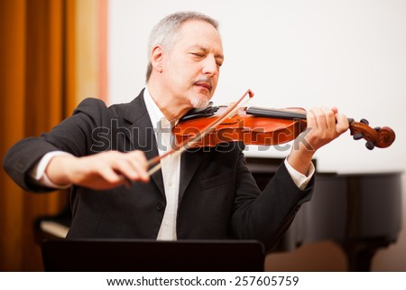 Musician playing his violin - stock photo