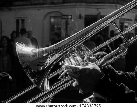 Musician playing jazz trombone in the French Quarter, New Orleans. - stock photo