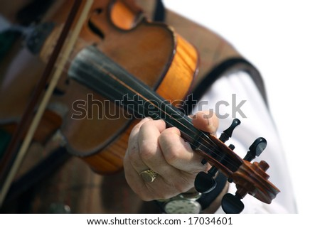 musician, playing old violine with clock on his hand - stock photo
