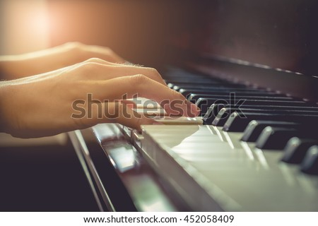 Musician playing piano in chruch with vintage filter. - stock photo