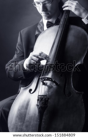 Musician playing the cello. Black-and-white photo - stock photo