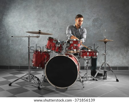 Musician playing the drums in a studio - stock photo