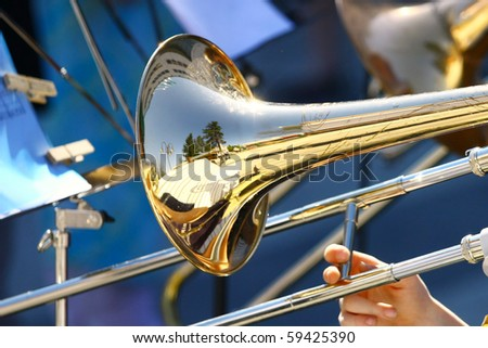 Musician playing the trumpet in the Orchestra - stock photo