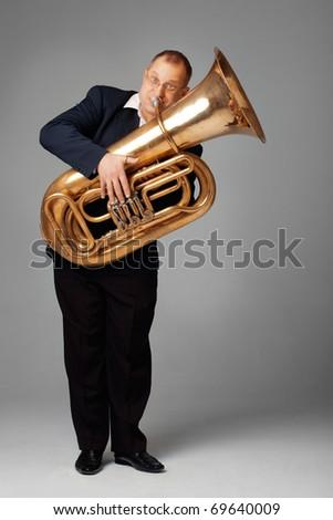 Musician playing the tuba - stock photo