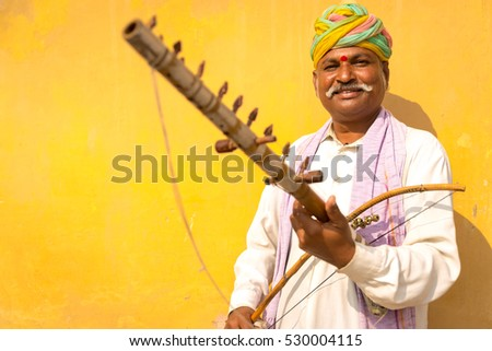 Musician playing traditional rajasthani music on the street of Jaipur, Rajasthan, India.