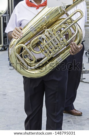 Musician playing trombone street celebration and event - stock photo