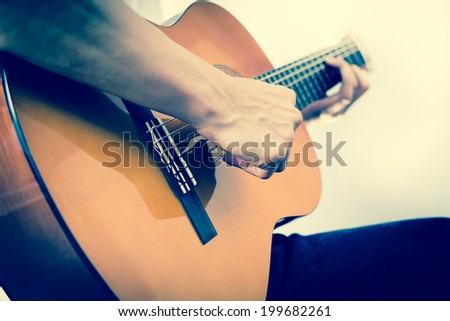 Musician plays Acoustic Guitar - stock photo