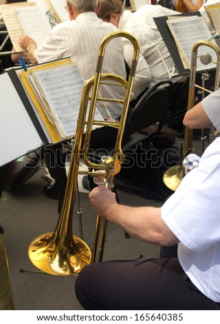 musician plays the trumpet in the orchestra - stock photo