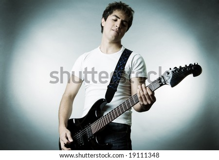 musician with guitar over grey background - stock photo