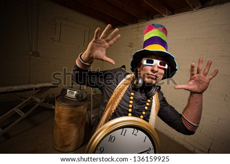 Musician with large hat and 3D glasses indoors - stock photo