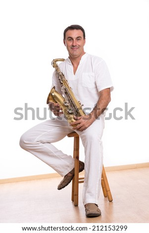 musician with saxophone in studio