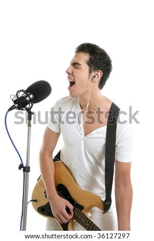 Musician young man playing electric guitar isolated on white - stock photo