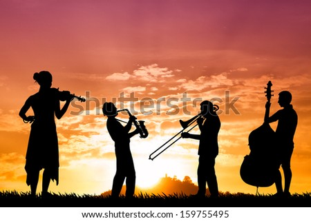 musicians at sunset