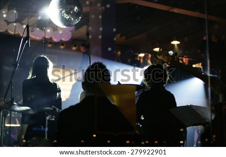 Musicians band playing in modern bar - restaurant - stock photo